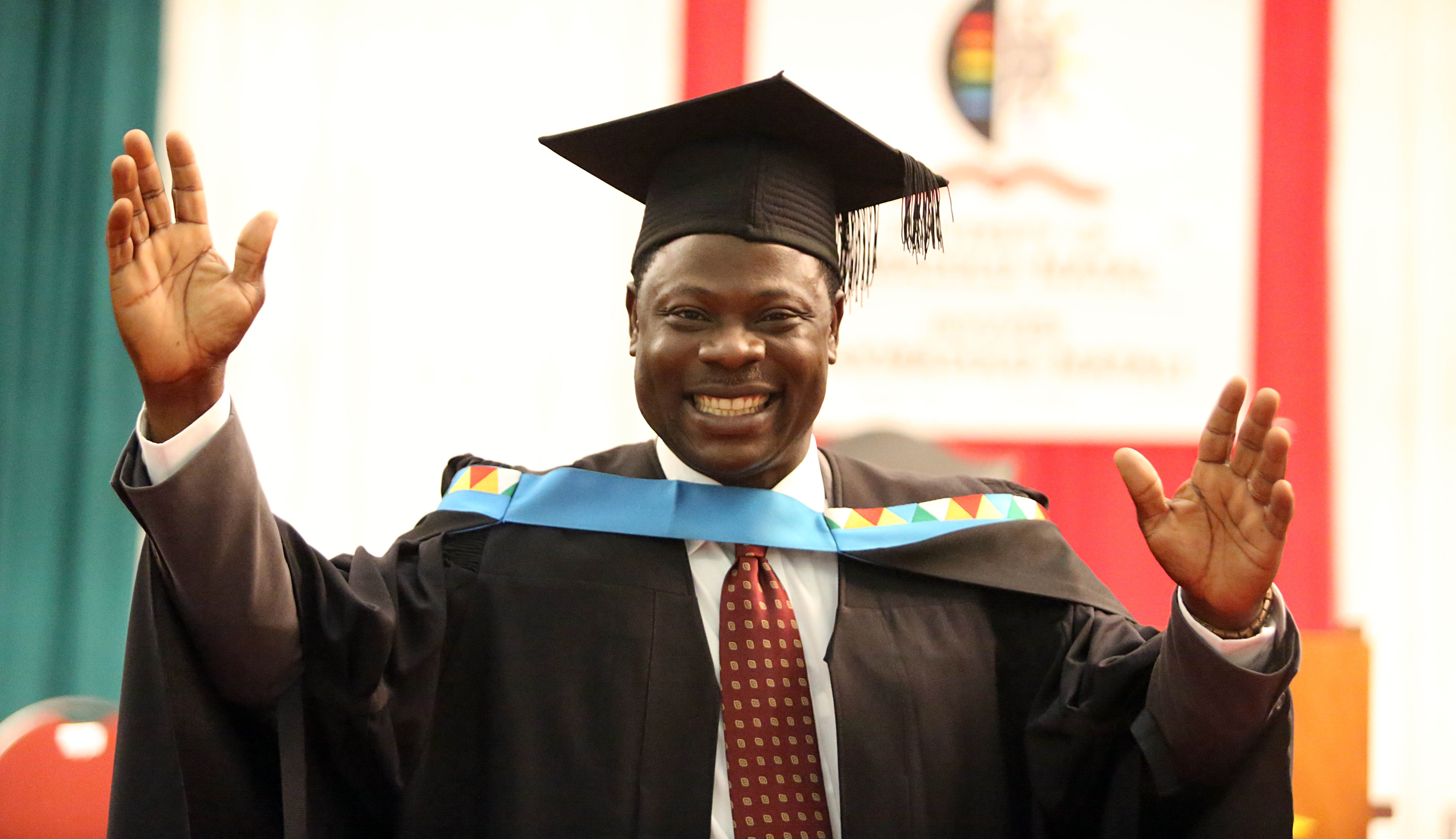 Mr Steve Tai Oladosu graduates with his Masters in Social Sciences cum laude.