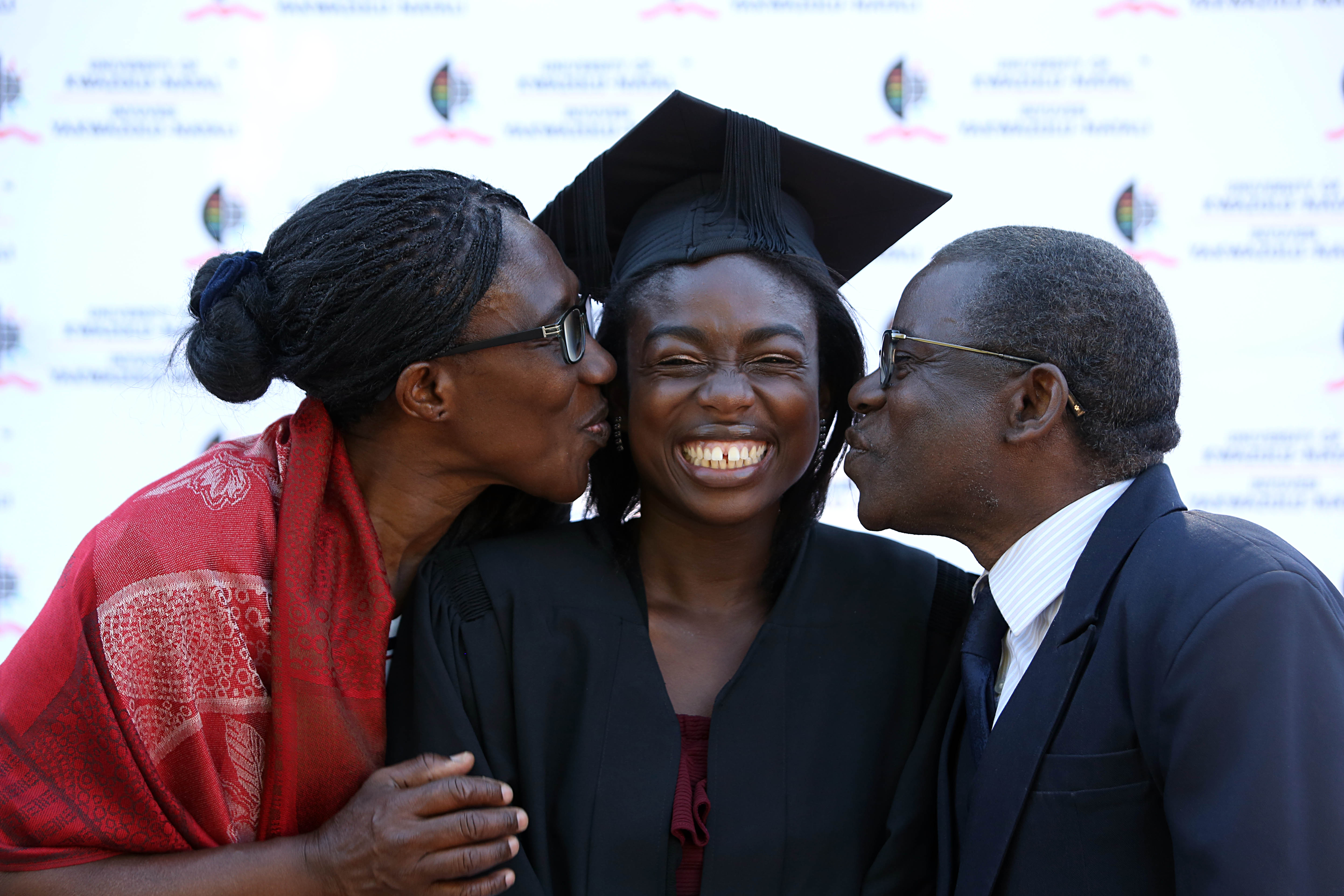 Ms Awo Quartey graduated with her Masters in Social Science. She is congratulated by her parents.