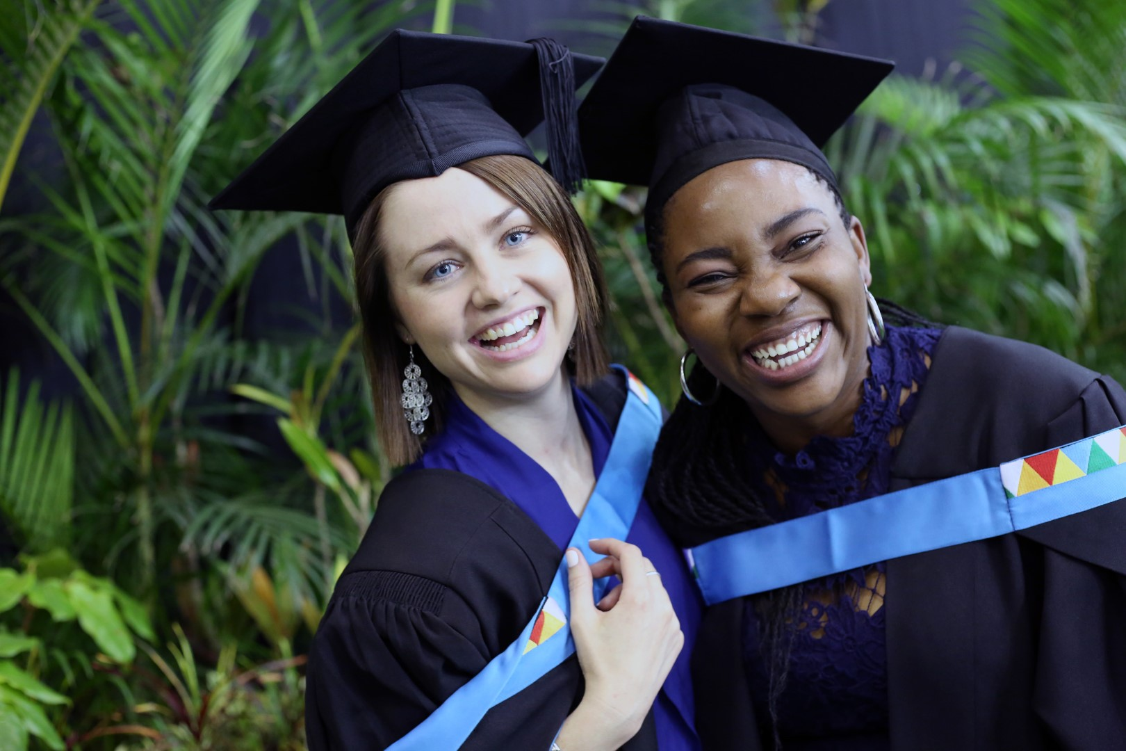 Masters of Social Sciences graduates Ms Claire Mondlana and Ms Sarah Jane O'Connell.