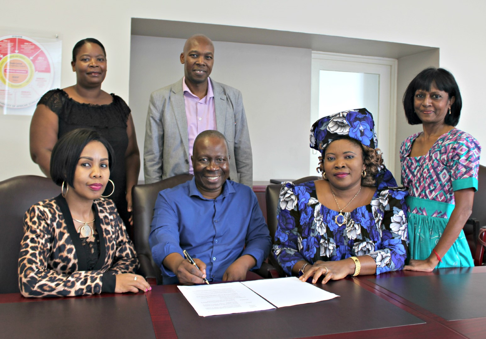 At the official announcement of the MOU between UKZN and the KZN Human Settlements Department are (from left, front) Ms Puseletso Nale of the KZN Department of Human Settlements; Prof Nhlanhla Mkhize; acting Dean of the School of Social Sciences Prof Vivian Ojong and Dr Desiree Manicom; and (back) Ms Zandile Cele of the KZN Department of Human Settlements and Dr Sthembiso Myeni.