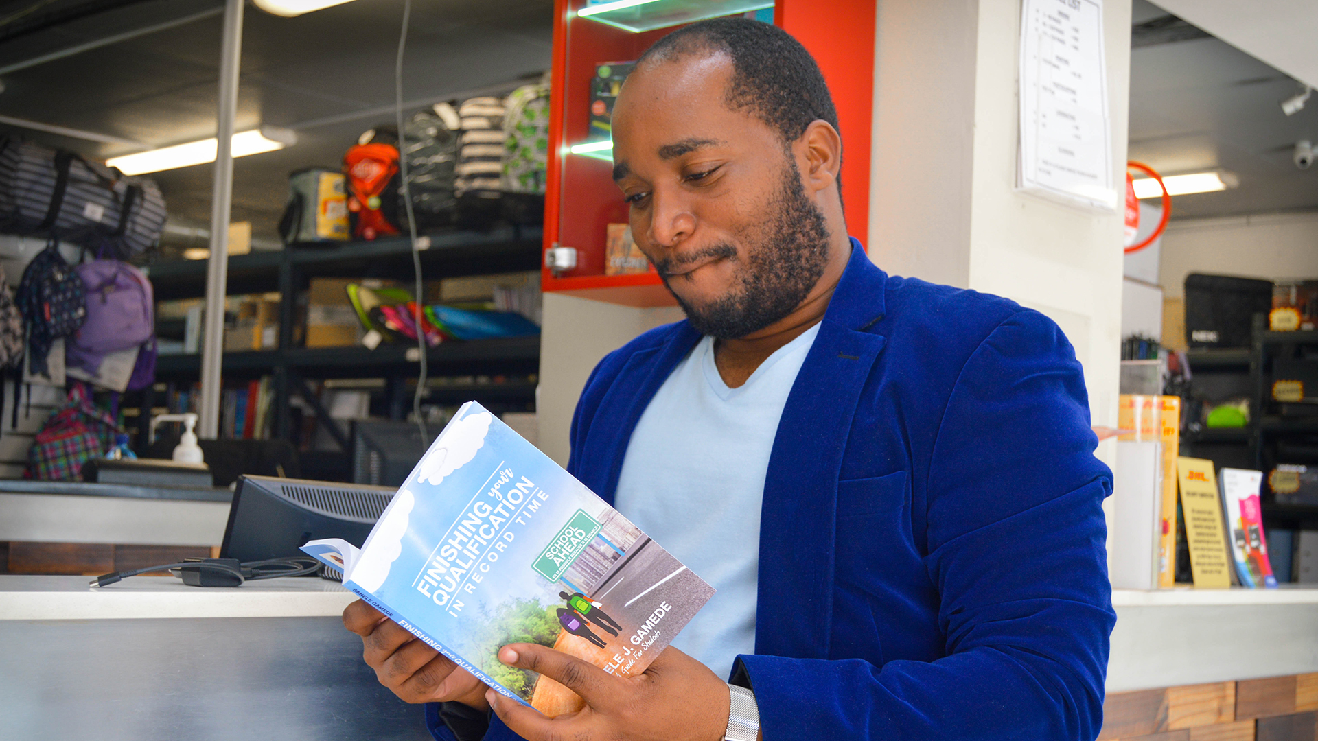 Mr Sanele Gamede with his new book